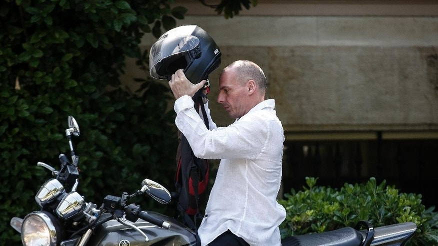 Greece's Finance Minister Yanis Varoufakis arrives for a cabinet meeting at Greek Prime Minister's office in Athens, Greece, on Sunday, June 21, 2015. Greece is struggling to reach a deal with its creditors for new loans that it needs to avoid defaulting on debt payments at the end of the month. Without the bailout, Greece could be headed for bankruptcy or an exit from the 19-nation eurozone.  (AP Photo/Yorgos Karahalis)
