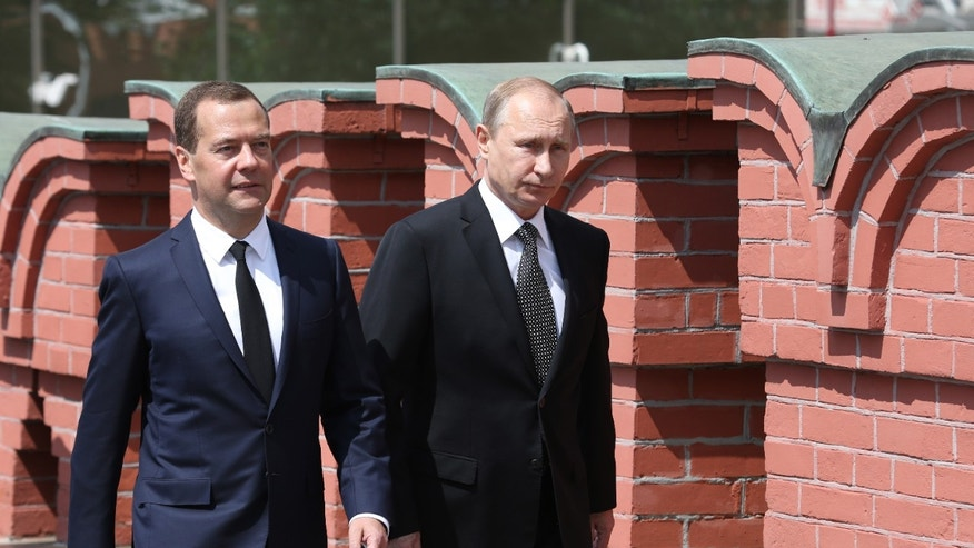 June 22, 2015 - Russian President Vladimir Putin, right, and Premier Dmitry Medvedev, walk along Moscow's Kremlin wall to take part in a wreath laying ceremony at the Tomb of the Unknown Soldier, marking the 74th anniversary of the Nazi invasion of the Soviet Union.