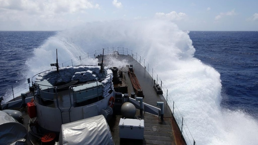 The Belgian Navy Vessel Godetia breaks waves during a migrants search and rescue mission in the mediterranean sea off the Sicilian coasts, Italy, Sunday, June 21, 2015. The Godetia Belgian Navy Vessel is among a EU Navy Vessels fleet taking part in the Triton migrant rescue operations. (AP Photo/Gregorio Borgia)