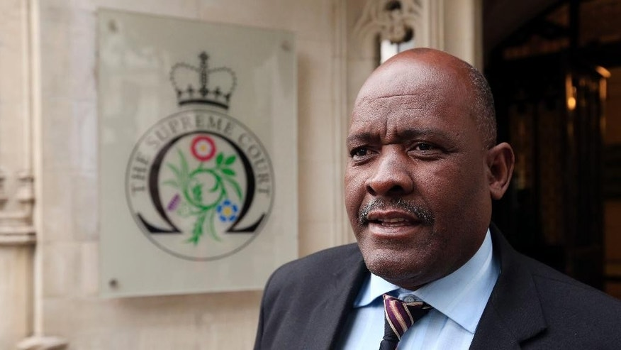 Louis Olivier Bancoult, leader of the Chagos Refugee Group, arrives at the Supreme Court in London, Monday June 22, 2015, as former residents of the Chagos Islands, in the Indian Ocean, are challenging a decision made six years ago by the House of Lords which dashed their hopes of returning home to their native islands. Families were forced to leave the islands in the 1960's and 1970's to make way for a United States Air Force base on the largest island, Diego Garcia. (Jonathan Brady/PA via AP)  UNITED KINGDOM OUT  NO SALES  NO ARCHIVE