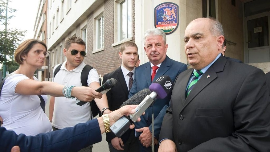 Serbian Police Director Milorad Veljovic, second right, and Karoly Papp, Chief Commissioner, Hungarian National Police, right, attend  a press conference about the joint actions against the migration at the Csongrad county police headquarters in Szeged, 170 kms southeast of Budapest, Hungary,Monday June 22, 2015. (AP Photo/MTI, Zoltan Gergely Kelemen)