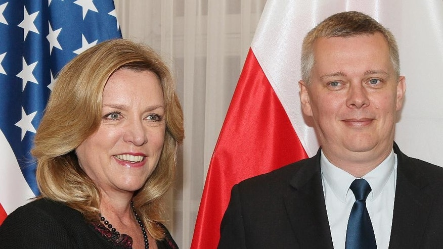 U.S. Secretary of the Air Force Deborah James, left, and Poland's Defense Minister Tomasz Siemoniak pose for photos before talks concerning security cooperation at the Defense Ministry in Warsaw, Poland, Monday, June 22, 2015. Poland is concerned about Russia's role in the armed conflict across its border, in  eastern Ukraine, and is seeking security assurances from its NATO and U.S. allies.   (AP Photo/Czarek Sokolowski)