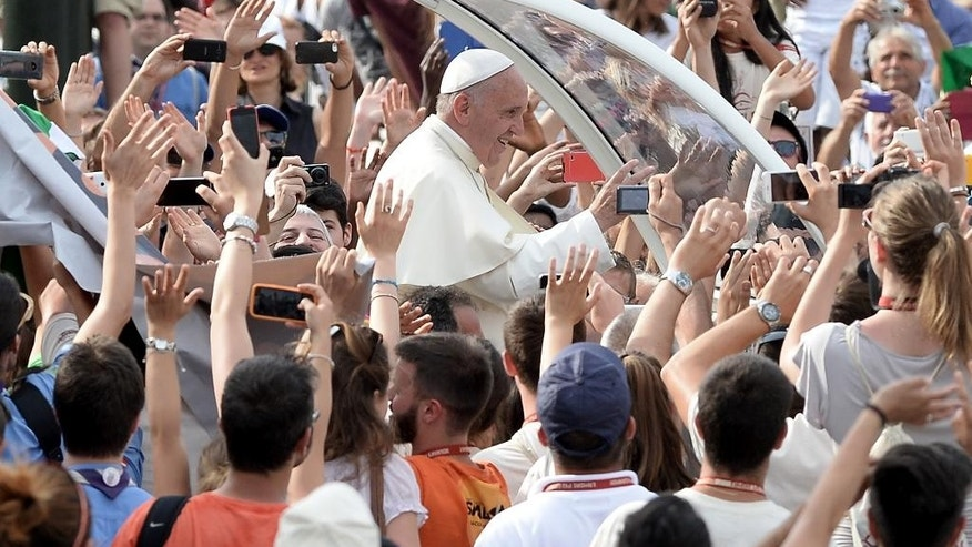 Pope Francis arrives for a meeting with the youths, in Turin, Italy, Sunday, June 21, 2015. Pope Francis earlier prayed in front of the Holy Shroud, the 14 foot-long linen revered by some as the burial cloth of Jesus, on display at the Cathedral of Turin. (AP Photo/Massimo Pinca)
