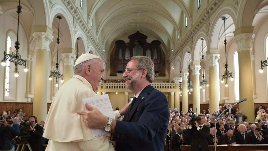Pope Francis shakes hands with Eugenio Bernardini, the Moderator of the Waldensian Church, during the first ever visit of a pope to the Waldensian evangelical church, in Turin, northern Italy, Monday, June 22, 2015. Pope Francis asked forgiveness Monday for the Catholic Church's persecution of members of this small evangelical church in Italy whose leader was excommunicated and followers branded as heretics during the Middle Ages.  (L' Osservatore Romano/Pool Photo via AP)