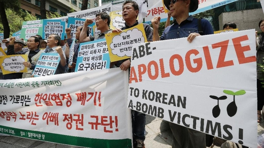 "South Korean protesters stage a rally to demand to break up diplomatic relations between South Korea and Japan in front of Japanese Embassy in Seoul, South Korea, Monday, June 22, 2015. Leaders of South Korea and Japan are attending ceremonies in their respective capitals Monday to mark the 50th anniversary since their countries normalized relations marred by Japan's colonization and World War II conquest. The letters on a banner read: ""We oppose Abe's government! Break up diplomatic relations between South Korea and Japan!"" (AP Photo/Ahn Young-joon)"