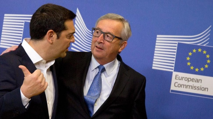 June 22, 2015 - Greek Prime Minister Alexis Tsipras, left, speaks with European Commission President Jean-Claude Juncker at EU headquarters in Brussels. Eurozone finance ministers broke off talks Monday without an agreement on Greece's bailout, saying they aim to reach a deal later this week.