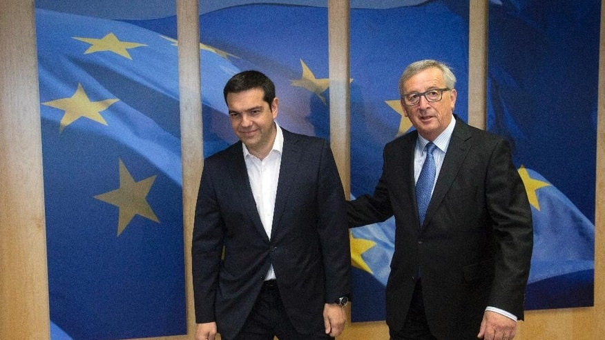European Commission President Jean-Claude Juncker, right, meets with Greek Prime Minister Alexis Tsipras ahead of an EU Summit in Brussels on Monday, June 22, 2015. Heads of state in the eurogroup will meet in Brussels on Monday for a special summit to discuss the financial crisis with Greece. (Olivier Hoslet/Pool Photo via AP)