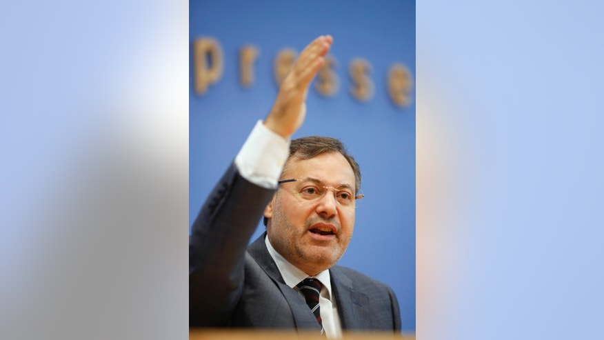 Al-Jazeera journalist Ahmed Mansour speaks during a news conference in Berlin, Germany, Tuesday, June 23, 2015. He was detained by German authorities on an Egyptian arrest warrant and emerged from a Berlin judicial building Monday again a free man after prosecutors decided not to pursue an extradition request further. (AP Photo/Markus Schreiber)