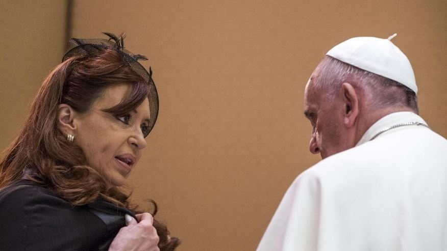 "FILE - In this June 7, 2015, file photo, Argentina's President Cristina Fernandez, left, shares a word with Pope Francis on the occasion of a private audience at the Vatican. Francis recently complained during an interview with Mexican television station Noticieros Televisa that he felt ""used"" by Argentine politicians who take their picture with him in Rome. (Angelo Carconi/Pool Photo via AP, File)"