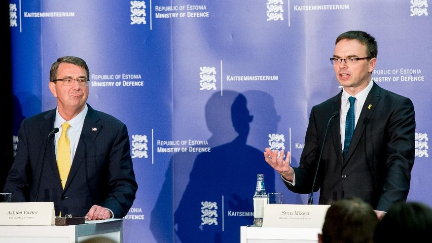 The US Secretary of Defense Ashton Carter, left, and Estonian Defense Minister Sven Mikser attend a joint press conference after a meeting in Tallinn, Estonia, Tuesday, June 23, 2015 . (AP Photo)