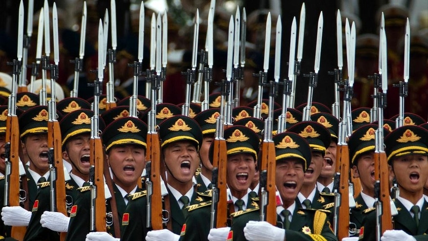 Members of a Chinese honor guard take part in a welcome ceremony for Belgium King Philippe in Beijing, Tuesday, June 23, 2015. Chinese organizers of a parade marking the end of World War II were keeping mum Tuesday over the sensitive question of which foreign countries' militaries had been invited to take part. (AP Photo/Ng Han Guan)