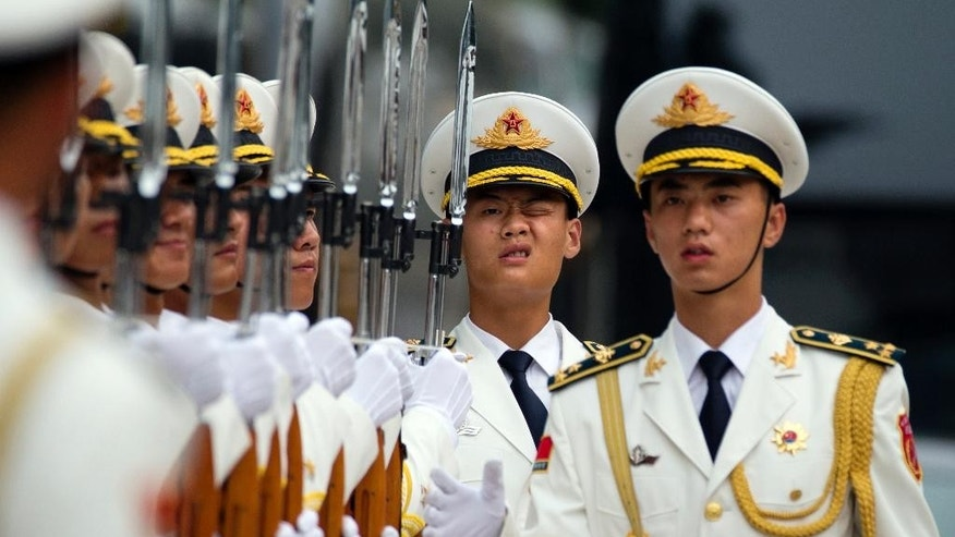 Members of a Chinese honor guard prepare for a welcome ceremony for the Belgium King in Beijing, Tuesday, June 23, 2015. Chinese organizers of a parade marking the end of World War II were keeping mum Tuesday over the sensitive question of which foreign countries' militaries had been invited to take part. (AP Photo/Ng Han Guan)