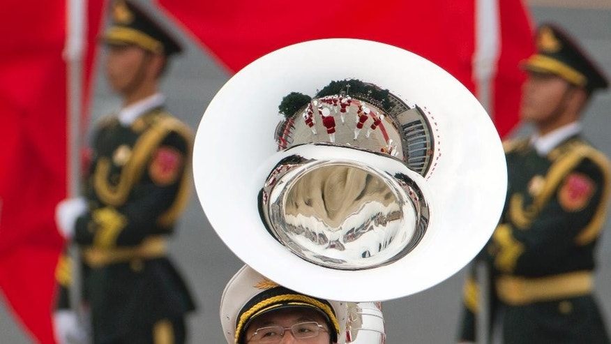 Members of a Chinese military band take part in a welcome ceremony for the Belgium King in Beijing, Tuesday, June 23, 2015. Chinese organizers of a parade marking the end of World War II were keeping mum Tuesday over the sensitive question of which foreign countries' militaries had been invited to take part. (AP Photo/Ng Han Guan)