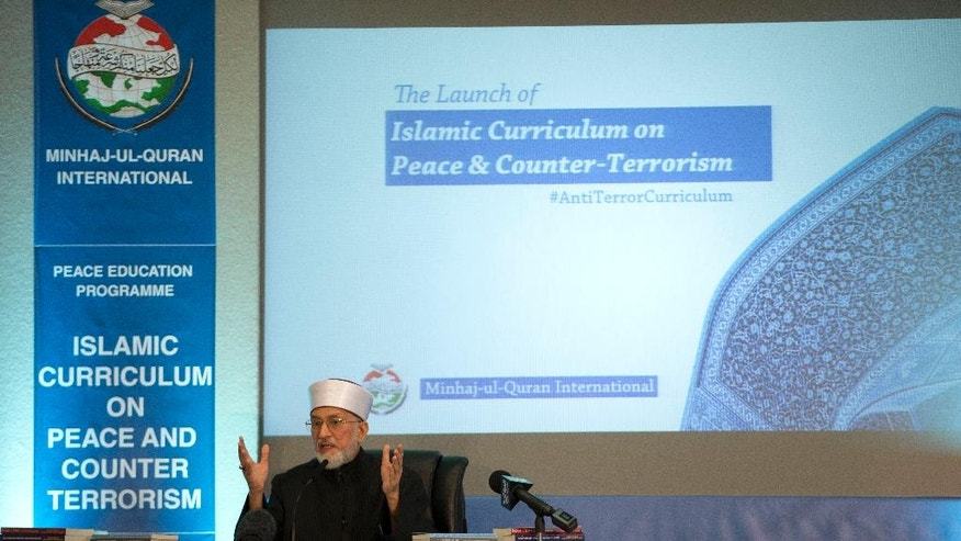 Pakistan cleric Shaykh-ul-islam Dr Muhammad Tahir-ul-Qadri, the founder of the Minhaj-ul-Quran International organization, delivers a keynote speech at the launch of the Islamic Curriculum on Peace and Counter Terrorism in London, Tuesday, June 23, 2015. The curriculum is described by the organizers of the event as a syllabus that provides material to form the basis of educational programs and campaigns against religious extremism and radicalization, and for the promotion of peace. (AP Photo/Matt Dunham)