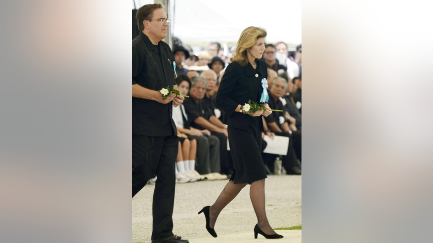 U.S. Ambassador to Japan Caroline Kennedy, followed by Alfred R. Magleby of the U.S. Consul General, Naha, walks to lay a flower during a memorial service at Peace Memorial Park in Itoman on Okinawa islands, Japan, Tuesday, June 23, 2015. Kennedy and Japanese Prime Minister Shinzo Abe attended the ceremony to mark the 70th anniversary of the Battle of Okinawa, one of the bloodiest conflicts of World War II. (Hiroko Harima/Kyodo News via AP) JAPAN OUT, MANDATORY CREDIT