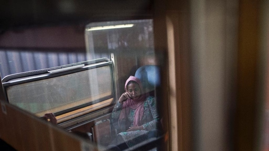 In this photo taken on Monday, June 22, 2015, a migrant sits in a compartment of a passenger train in Presevo, close to the Serbian border with Macedonia, 300 kilometers southeast of Belgrade, Serbia. As Hungary ponders building a 4-meter (13-foot) high fence on its 175-kilometer (109-mile) border with Serbia to keep the migrants away, refugees insist that they have no other choice but to move on. (AP Photo/Marko Drobnjakovic)