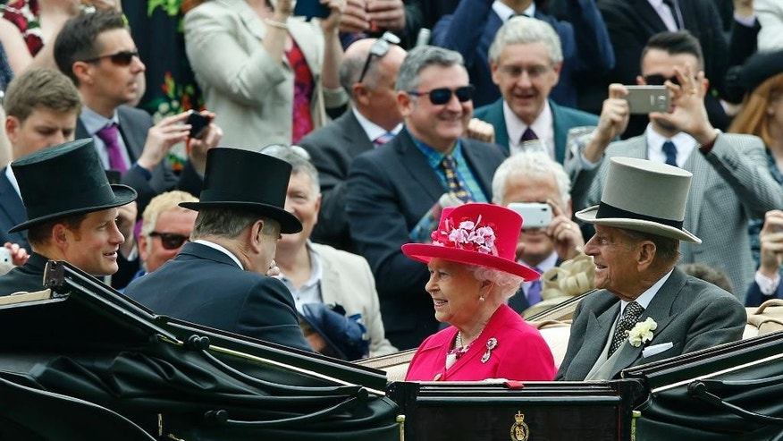 FILE - A Tuesday June 16, 2015 file photo showing Britain's Queen Elizabeth II arriving with Prince Philip, the Duke of Edinburgh and Prince Harry for the first day of  Royal Ascot horse racing meet at Ascot, England. The queen is planning to leave Tuesday, June 23, 2015, on a state visit to Germany that will include her first visit to a former concentration camp site. She and her husband Prince Philip plan to visit the Bergen-Belsen camp where diarist Anne Frank and her sister Margot died just weeks before the British liberated it on April 15, 1945. (AP Photo/Alastair Grant, File)