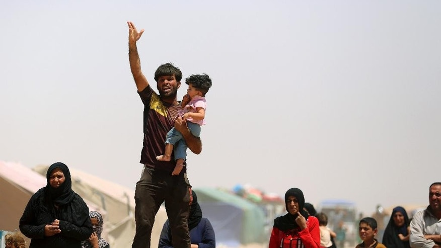 FILE - In this Friday, May 22, 2015 file photo, displaced civilians from Ramadi and around the central Iraqi area live in a camp in the town of Amiriyat al-Fallujah, west of Ramadi, 65 kilometers (40 miles), west of Baghdad. The number of people displaced within Iraq due to violence and fighting by the Islamic State group has exceeded 3 million, the United Nations said Tuesday, June 23, a grim milestone for the war-battered country. (AP Photo/Hadi Mizban)