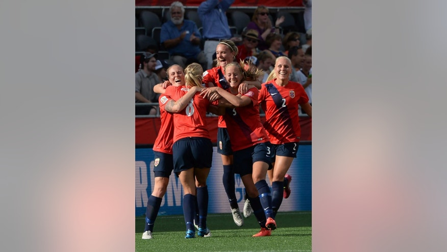 Norway's Solveig Gulbrandsen (8) celebrates with teammates after scoring against England during second half FIFA Women's World Cup round of 16 soccer action in Ottawa, Ontario, Canada, on Monday, June 22, 2015. (Sean Kilpatrick/The Canadian Press via AP) MANDATORY CREDIT