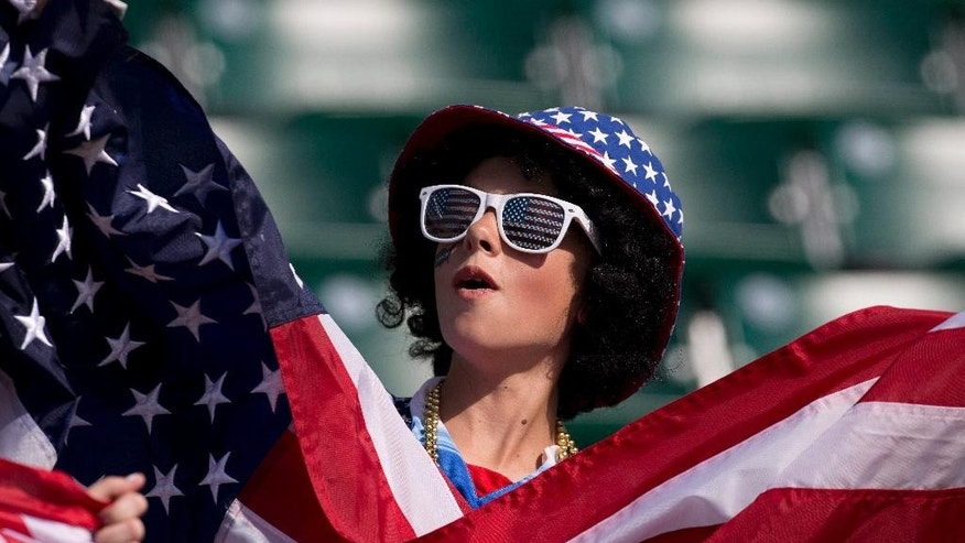 A United States fan displays a flag for their team before the FIFA Women's World Cup round of 16 action against Colombia in Edmonton, Alberta,  Canada, Monday June 22, 2015. (Jason Franson/The Canadian Press via AP) MANDATORY CREDIT