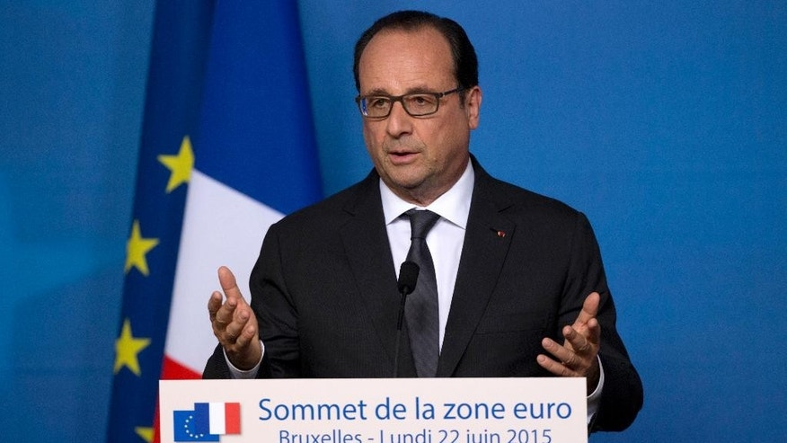 FILE - In this June 22, 2015, file photo, French President Francois Hollande speaks during a media conference at an EU summit in Brussels. WikiLeaks published documents late Tuesday, June 23, 2015, that it says show the U.S. National Security Agency eavesdropped on the last three French presidents, Hollande, Nicolas Sarkozy and Jacques Chirac, releasing material which appeared to capture officials in Paris talking candidly about Greece's economy, relations with Germany — and, ironically, American espionage. (AP Photo/Michel Euler, File)