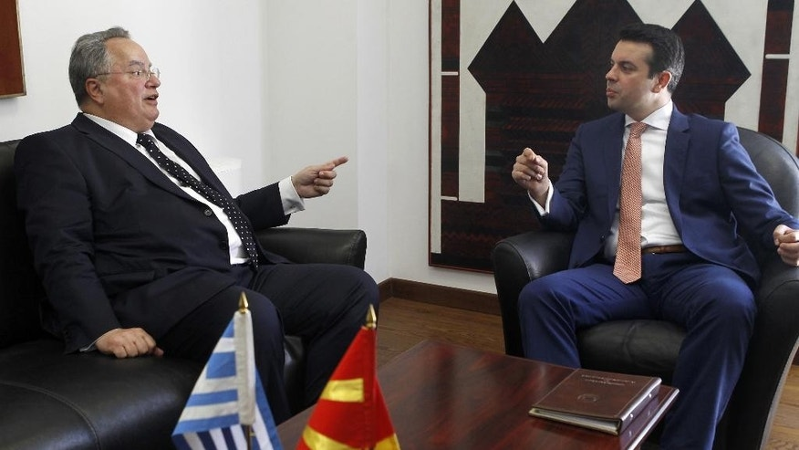 Greek Foreign Minister Nikos Kotzias, left, gestures while talking to his Macedonian counterpart Nikola Poposki during their meeting at the Foreign Ministry building in Skopje, Macedonia, on Wednesday, June 24, 2015. Minister Kotzias will meet Macedonian top officials during his visit to Skopje, as a part of his regional trip which included Belgrade and Podgorica. (AP Photo/Boris Grdanoski)