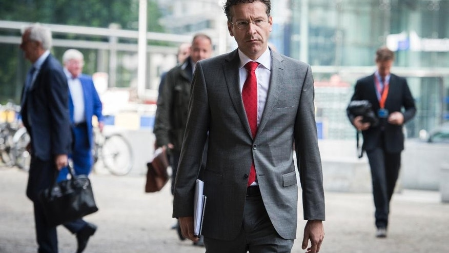 Dutch Finance Minister Jeroen Dijsselbloem, center, arrives for a meeting at EU headquarters in Brussels on Wednesday, June 24, 2015. Eurozone finance ministers meet Wednesday to discuss the Greek bailout. (AP Photo/Wiktor Dabkowski)