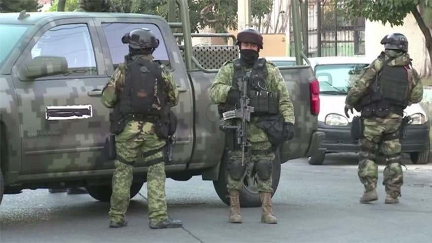 "Mexican police outside the house where Ruben Oseguera Gonzalez - a.k.a., ""El Menchito"" - was arrested. (Source: Via YouTube)"