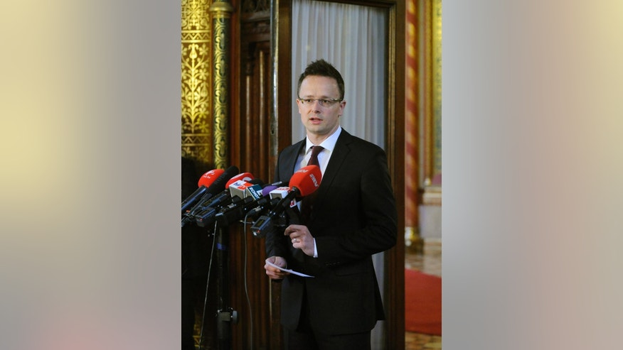 Hungarian Minister of Foreign Affairs and Trade Peter Szijjarto, speaks during a press conference  in the Parliament building in Budapest, Hungary, Wednesday, June 24, 2015. Hungary's foreign minister says the government has decided to build a temporary fence on the border with Serbia as fast as possible to stop the flow of illegal migrants.  (Zoltan Mathe/MTI via AP)