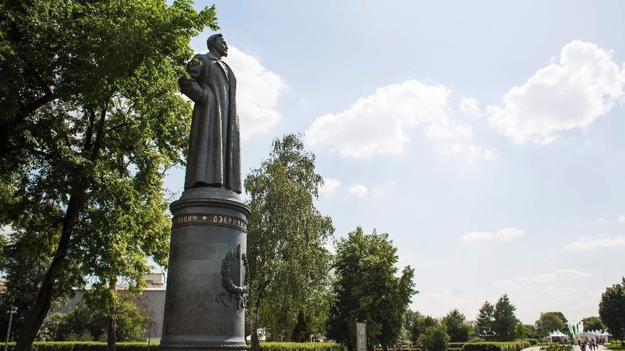 A statue of Felix Dzerzhinsky, the founder of the Soviet secret police, stands in the Museon Park, also known as Fallen Monument Park, in Moscow, Russia, Wednesday, June 24, 2015. The Moscow city legislature has agreed to allow residents to decide whether the statue of Felix Dzerzhinsky should be restored to a square in central Moscow. The statue of the Bolshevik revolutionary known as Iron Felix stood outside KGB headquarters in Moscow until it was toppled by protesters in 1991 in the final months of the Soviet Union. (AP Photo/Alexander Zemlianichenko)