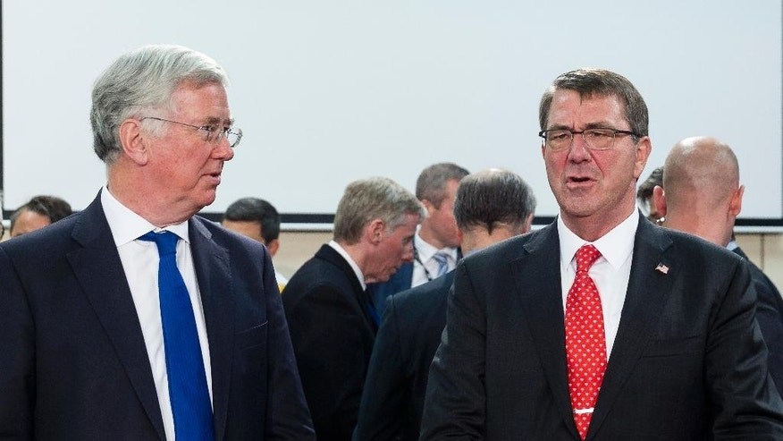 "US Secretary of Defense Ashton Carter, right, speaks with British Secretary of State for Defense Michael Fallon at the start of a meeting at EU headquarters in Brussels on Wednesday, June 24, 2015. Alliance defense ministers gathered in Brussels for a meeting that is expected to increase the size of NATO's Response Force and streamline procedure for deployment of its new, ultrafast ""spearhead"" unit of 5,000 ground troops. (AP Photo/Thierry Monasse)"