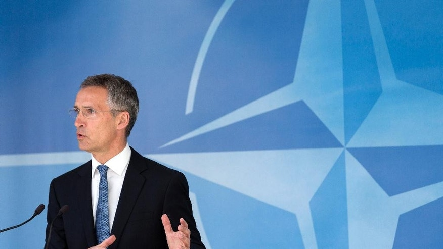 "NATO Secretary General Jens Stoltenberg gestures as he speaks during a media conference at EU headquarters in Brussels on Wednesday, June 24, 2015. Alliance defense ministers gathered in Brussels for a meeting that is expected to increase the size of NATO's Response Force and streamline procedure for deployment of its new, ultrafast ""spearhead"" unit of 5,000 ground troops. (AP Photo/Thierry Monasse)"