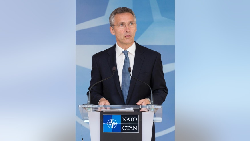 "NATO Secretary General Jens Stoltenberg speaks during a media conference at EU headquarters in Brussels on Wednesday, June 24, 2015. Alliance defense ministers gathered in Brussels for a meeting that is expected to increase the size of NATO's Response Force and streamline procedure for deployment of its new, ultrafast ""spearhead"" unit of 5,000 ground troops. (AP Photo/Thierry Monasse)"