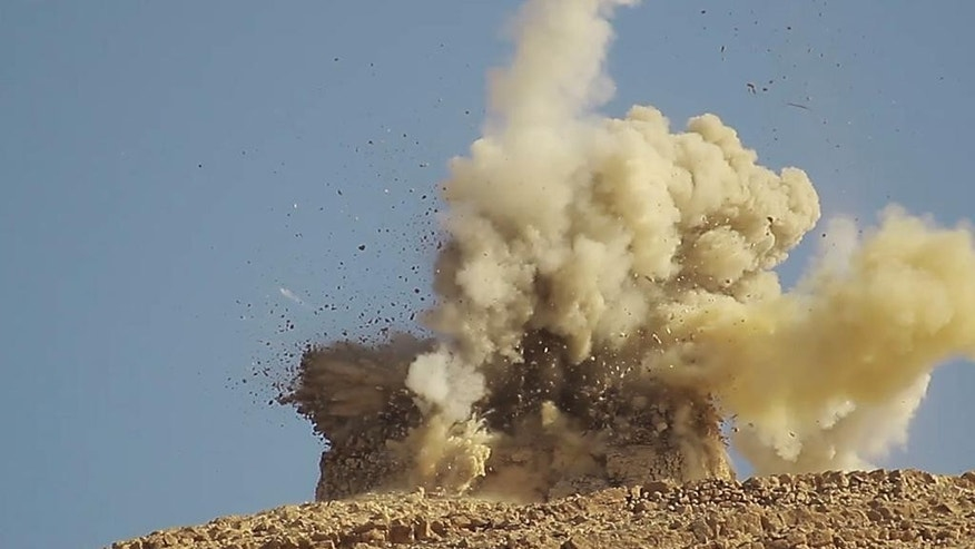 This undated photo released on June 22, 2015, by a militant website, which has been verified and is consistent with other AP reporting, shows one of two mausoleums blowing up by the Islamic State militants, in the historic central town of Palmyra, Syria. A Syrian official says the Islamic State group has destroyed two mausoleums in the historic central town of Palmyra. Maamoun Abdulkarim, the head of the Antiquities and Museums Department in Damascus, tells The Associated Press that one of the tombs belongs to Mohammad Bin Ali, a descendant of Islam's Prophet Muhammad's cousin Imam Ali. (The website of Islamic State militants via AP)