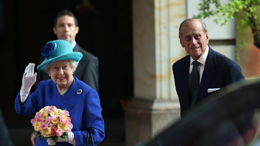 Britain's Queen Elizabeth II, left, waves as she and Prince Philip, the Duke of Edinburgh, arrive at their hotel in Germany's capital Berlin, Tuesday, June 23, 2015. Queen Elizabeth II and her husband Prince Philip are on an official visit to Germany until Friday, June 26. (Joerg Carstensen/dpa via AP)