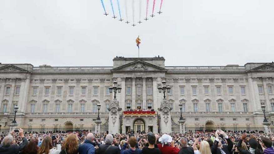 In this Saturday, June 13, 2015 file photo, the Red Arrows perform a flypast during the Trooping The Colour parade at Buckingham Palace, in London.