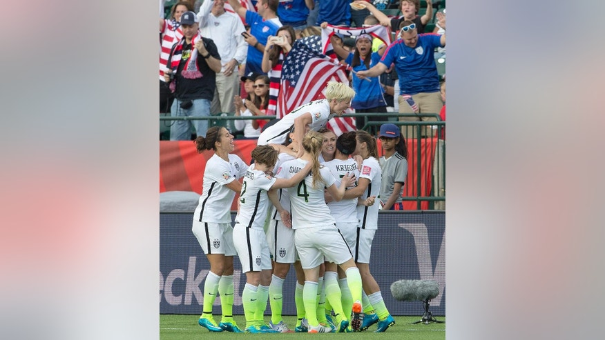 The United States team celebrates a goal against Colombia during second half FIFA Women's World Cup round of 16 soccer action in Edmonton, Alberta, Canada, Monday, June 22, 2015.  (Jason Franson/The Canadian Press via AP) MANDATORY CREDIT
