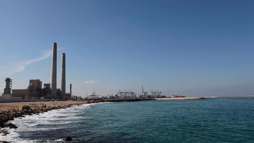 FILE - This Thursday, Oct. 7, 2015 file photo shows a general view of the Eshkol power station, the first in Israel to produce electricity from natural gas, in the coastal city of Ashdod, southern Israel. When natural gas was discovered a few years ago off the shores of resource-poor Israel, it was heralded as nothing short of a miracle, but an emerging deal with developers has been plagued by criticism, with opponents accusing Prime Minister Benjamin Netanyahu of caving to a monopoly.(AP Photo/Tsafrir Abayov, File)