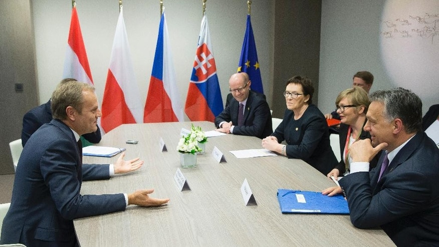 From left, European Council President Donald Tusk, Czech Republic Prime Minister Bohuslav Sobotka, Polish Prime Minister Ewa Kopacz and Hungarian Prime Minister Viktor Orban participate in the Visegrad meeting ahead of the European Summit at the EU Council headquarters in Brussels, on Thursday, June 25, 2015. (Julien Warnand/Pool Photo via AP