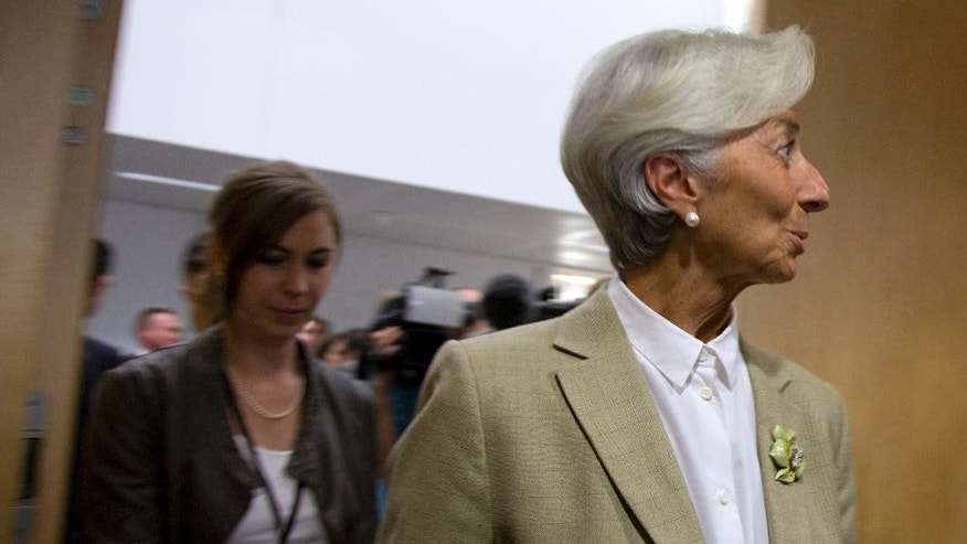 Managing Director of the International Monetary Fund Christine Lagarde, right, arrives for a round table meeting of eurogroup finance ministers at the EU LEX building in Brussels on Wednesday, June 24, 2015. Eurozone finance ministers meet Wednesday to discuss the Greek bailout. (AP Photo/Virginia Mayo)