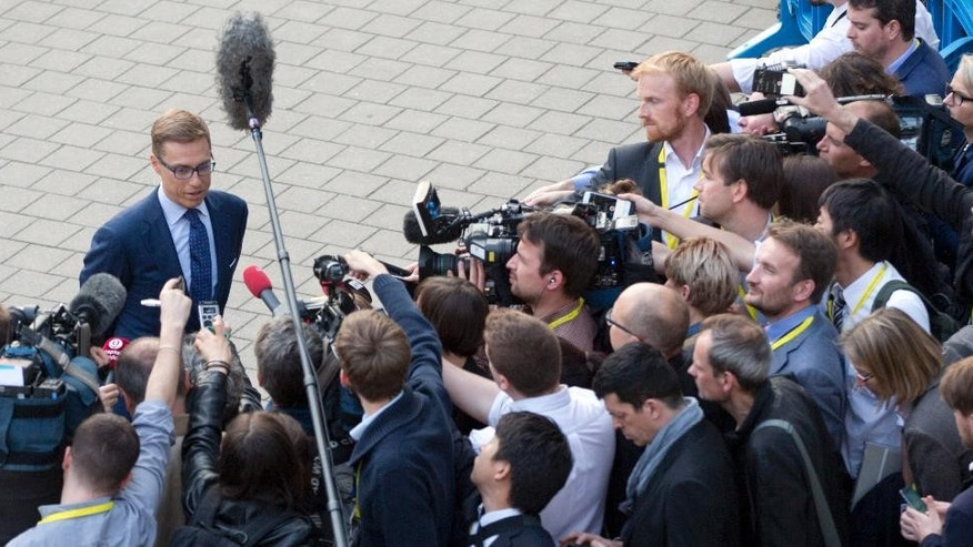 Finland's Finance Minister Alexander Stubb speaks with the media after a meeting of eurogroup finance ministers at the EU LEX building in Brussels on Wednesday, June 24, 2015. With major differences remaining between Greece and its creditors, eurozone finance ministers cut short a meeting on Greece's proposals to avoid a default and planned to meet again Thursday. (AP Photo/Virginia Mayo)