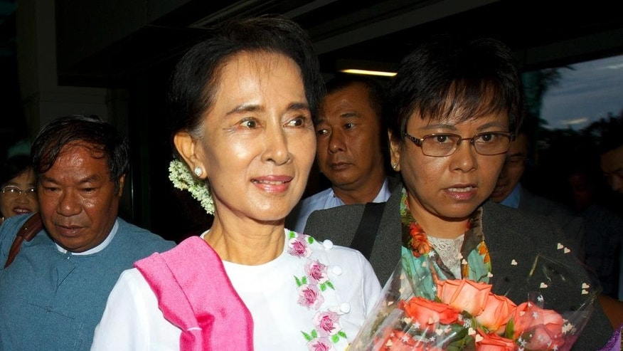 FILE - In this June 10, 2015 file photo, Myanmar's opposition leader Aung San Suu Kyi arrives at Yangon International Airport to depart for China. Myanmar's parliament voted against constitutional amendments Thursday, June 25 ensuring that the military's veto power remains intact and that Suu Kyi cannot become president in an election this year. (AP Photo/Khin Maung Win, File)