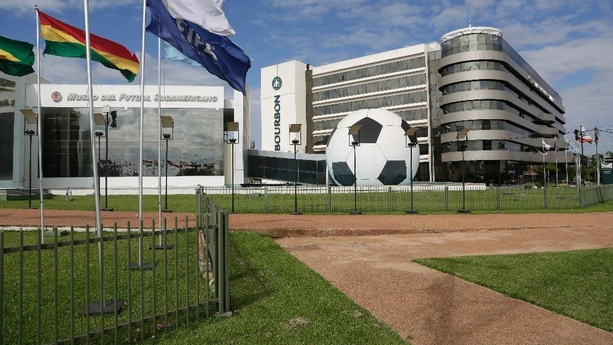 FILE - In this June 3, 2015 file photo, CONMEBOL headquarters sits on a 100-acre complex and includes a museum, a five-star luxury hotel, a large convention center and heliport, in Asuncion, Paraguay. Paraguay's president signed a law on Thursday, June 25, 2015 repealing the immunity that this headquarters enjoyed for nearly two decades, part of the fallout from a U.S. investigation into an alleged bribery scheme in FIFA. (AP Photo/Jorge Saenz, File)