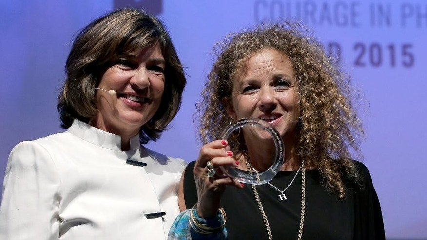CNN journalist Christiane Amanpour, left, hands over the '2015 Anja Niedringhaus Award' to photographer Heidi Levine, right, in Berlin, Germany, Thursday, June 25, 2015. The Anja Niedringhaus Courage in Photojournalism Award was created to honor the life and work of Pulitzer Prize-winning AP photographer Anja Niedringhaus (1965-2014). (AP Photo/Michael Sohn)