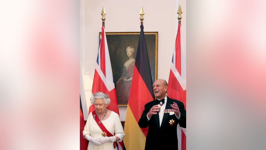 Britain's Queen Elizabeth II, left, looks on as Prince Philip, the Duke of Edinburgh, right, laughs prior to a State Banquet hosted by President Gauck in Bellevue Palace in Berlin Wednesday, June 24, 2015. Queen Elizabeth and Prince Philip are on a state visit to Germany until Friday, June 26. (Wolfgang Kumm/pool via AP)