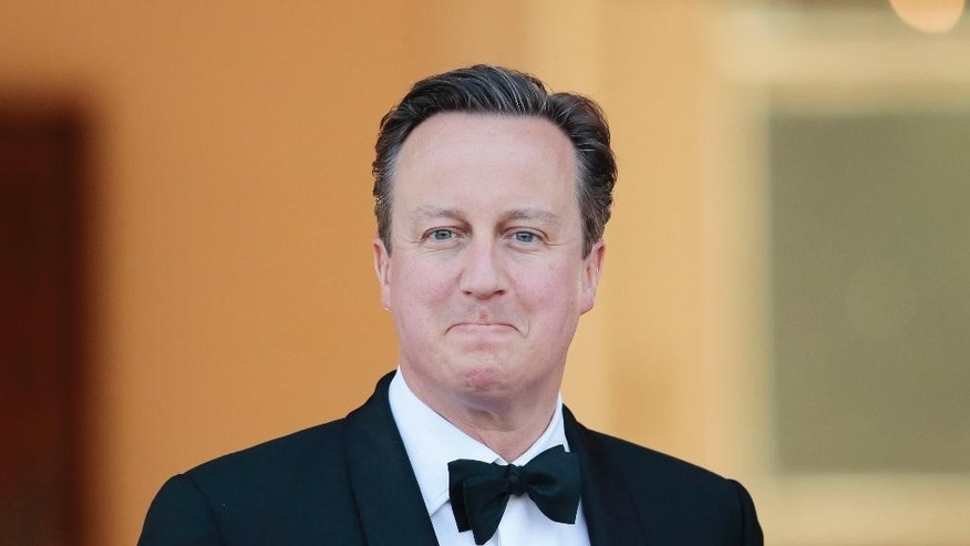 British Prime Minister David Cameron arrives for an official state dinner for Britain's Queen Elizabeth II, in front of Germany's President Joachim Gauck's residence Bellevue Palace in Berlin, Wednesday, June 24, 2015. Queen Elizabeth II and her husband Prince Philip are on an official visit to Germany until Friday, June 26. (AP Photo/Markus Schreiber)