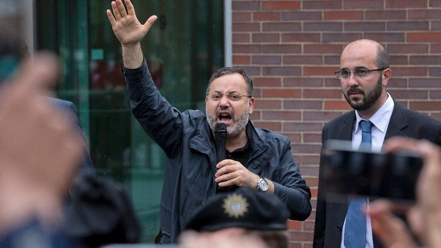 FILE - In this Monday, June 22, 2015, file photo, Ahmed Mansour delivers a statement after he left the security checkpoint of the Moabit jail in Berlin, Germany. Ahmed Mansour, 52, a senior journalist with the Qatar-based broadcaster Al-Jazeera, was detained at Tegel airport on Saturday on an Egyptian arrest warrant. A watchdog group says journalists face unprecedented threats in President Abdel-Fattah el-Sissi's Egypt, with the highest number behind bars since its records started in 1990. (AP Photo/Michael Sohn, File)