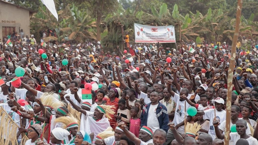 Part of the crowd gathered to listen to Burundian President Pierre Nkurunziza during presidential campaigning Friday, June 26, 2015, in Giteranyi, Muyinga, Burundi.  Burundi has experienced weeks of unrest since the ruling party's April 26th announcement that President Pierre Nkurunziza will run for a third term in office. (AP Photo/Gildas Ngingo)