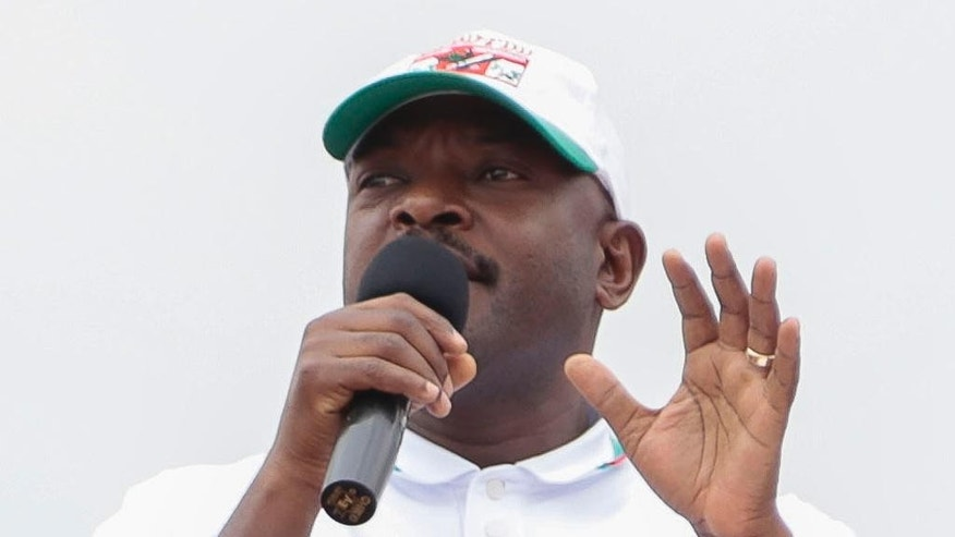 Burundian President Pierre Nkurunziza, middle, speaking during presidential campaigning Friday June 26, 2015, in Giteranyi, Muyinga, Burundi.  Burundi has experienced weeks of unrest since the ruling party's April 26th announcement that President Pierre Nkurunziza will run for a third term in office. (AP Photo/Gildas Ngingo)
