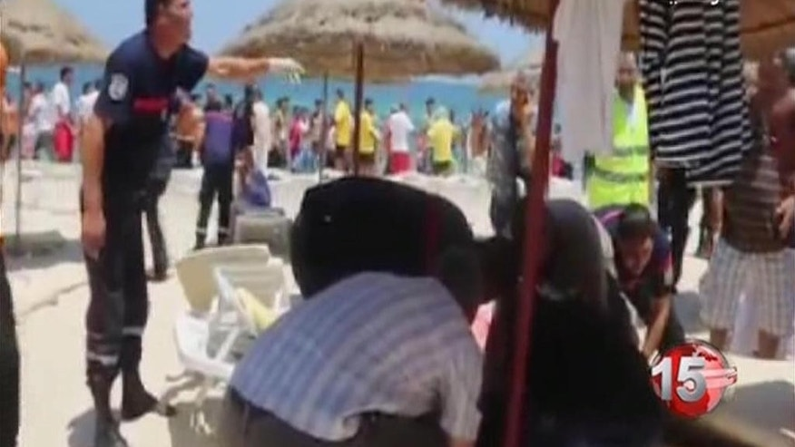 Injured people are treated near the area where an attack took place in Sousse, Tunisia, Friday June 26, 2015. A young man unfurled an umbrella and pulled out a Kalashnikov, opening fire on European sunbathers in an attack that killed at least 28 people at a Tunisian beach resort — one of three deadly attacks from Europe to the Middle East on Friday that followed a call to violence by Islamic State extremists. (AP Photo/Hassene Dridi)